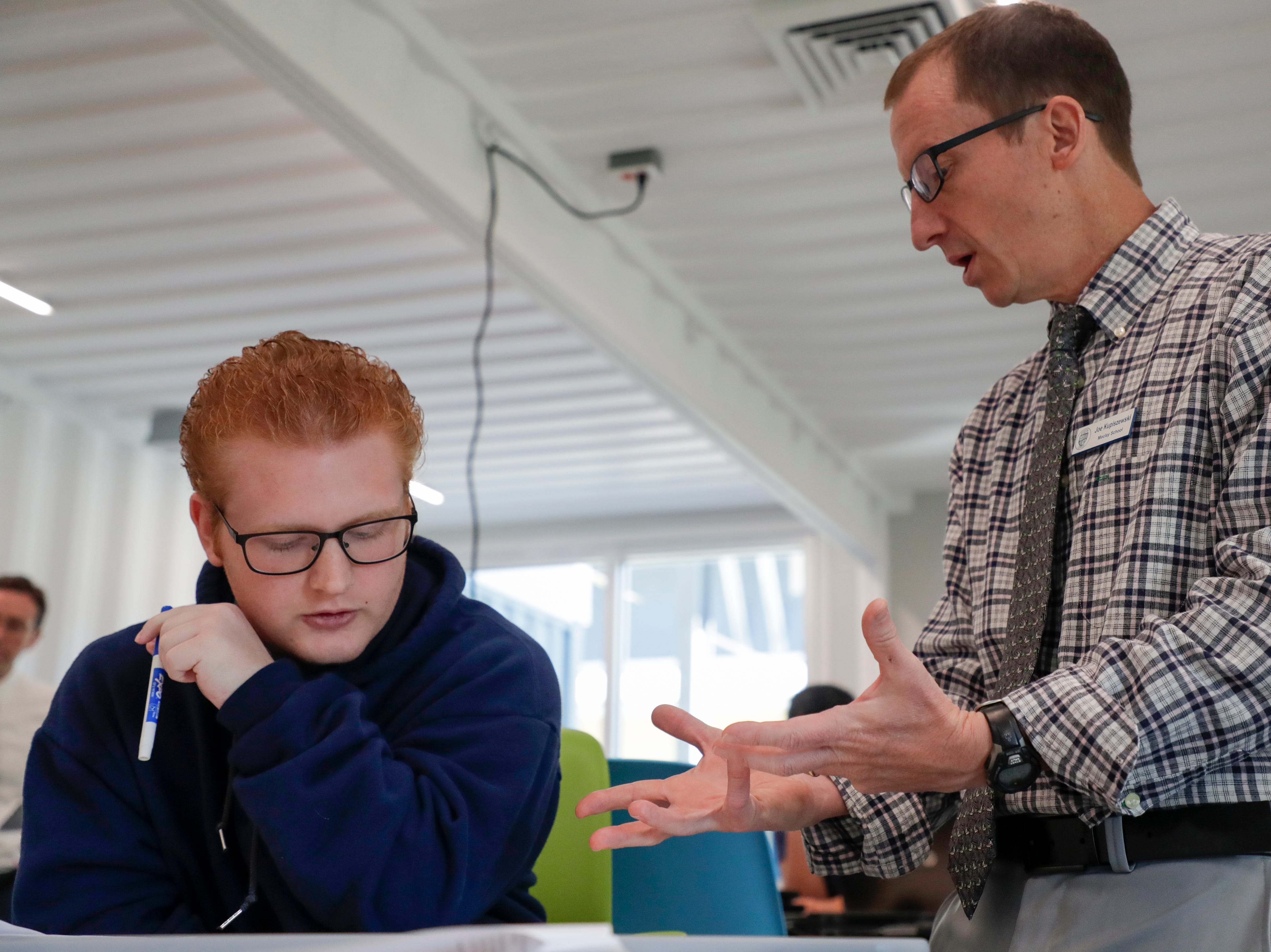 Maclay School Computer Science and Engineering Teacher Joe Kupiszewski works with junior Atticus Mazerac in the computer science, robotics and engineering classroom in the new Beck Family Research Center on the Maclay School campus Wednesday, May 15, 2019.