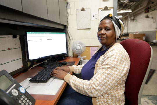 Gaudence Umutesi, an inserter two for the Tallahassee Democrat, poses for a photo at her computer Wednesday, May 15, 2019.