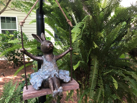 Bunny adds a touch of whimsy to Kathryn and Robert's garden, which has a collection of bromiliads and miniature gardens.