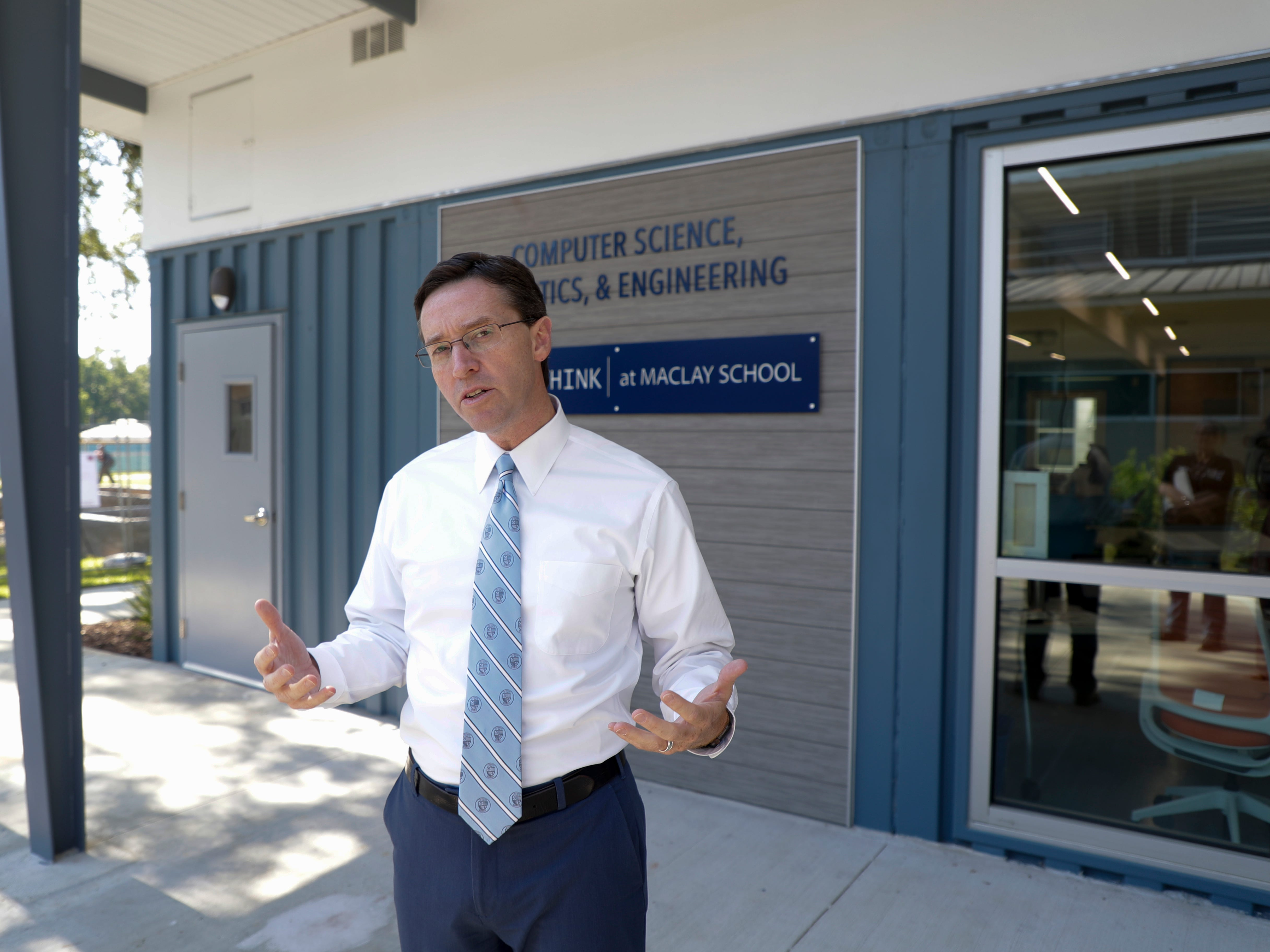 Maclay Head of School James Milford gives a rundown of the new Beck Family Research Center, a group of three classrooms made from recycled shipping containers, on the Maclay campus Wednesday, May 15, 2019.