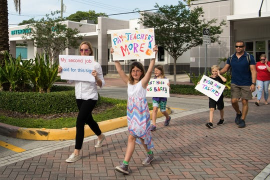 """People march in support of reforms to Florida's public education system Wednesday, May 15, 2019, in Stuart. The event was organized by the Facebook group page """"Reconstruct-ED: A Message to Governor DeSantis,"""" which lists over-testing and low teacher pay among their concerns."""