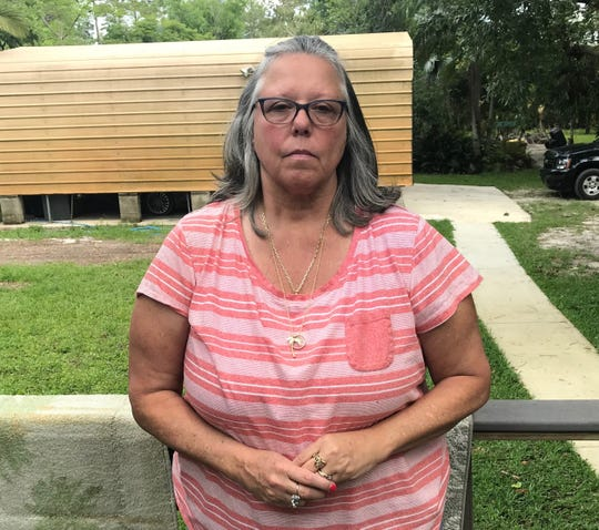 Cindy Collins outside her Palm City home on May 14, 2019.