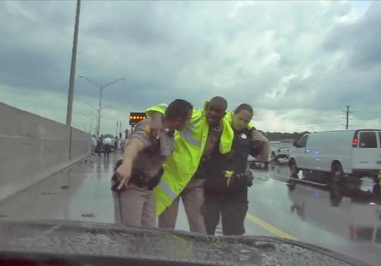 FHP Trooper Jeremy Medastin jumped onto a barrier wall on I-95 but not high enough to avoid being hit by a car out of control on I-95 May 13, 2019.