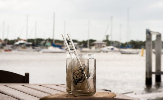 "Glass straws, like those seen here on an outside table overlooking the south fork of the St. Lucie River in Stuart on Thursday, April 18, 2019, are used for drinks served in-house at Gilbert's Coffee Bar, while ""HAY! Straws"" are used for drinks to-go. The Legislature approved HB 771 during the session, which would have prohibited local governments from enforcing plastic straw bans until July 2024. Gov. Ron DeSantis vetoed it."
