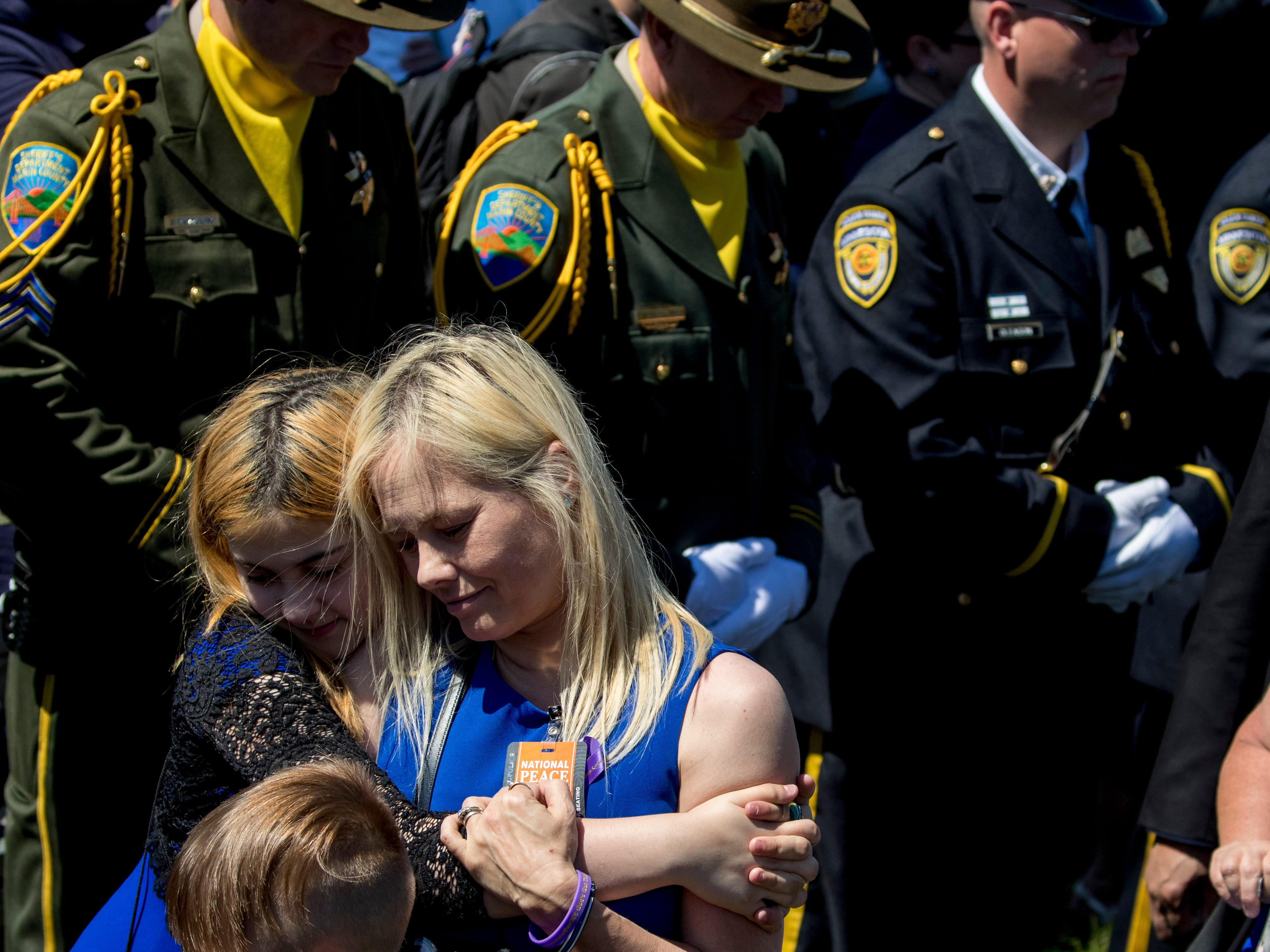 Families of fallen police officers arrive at the 38th Annual National Peace Officers Memorial Service on the West Lawn of the Capitol Building, Wednesday, May 15, 2019, in Washington.