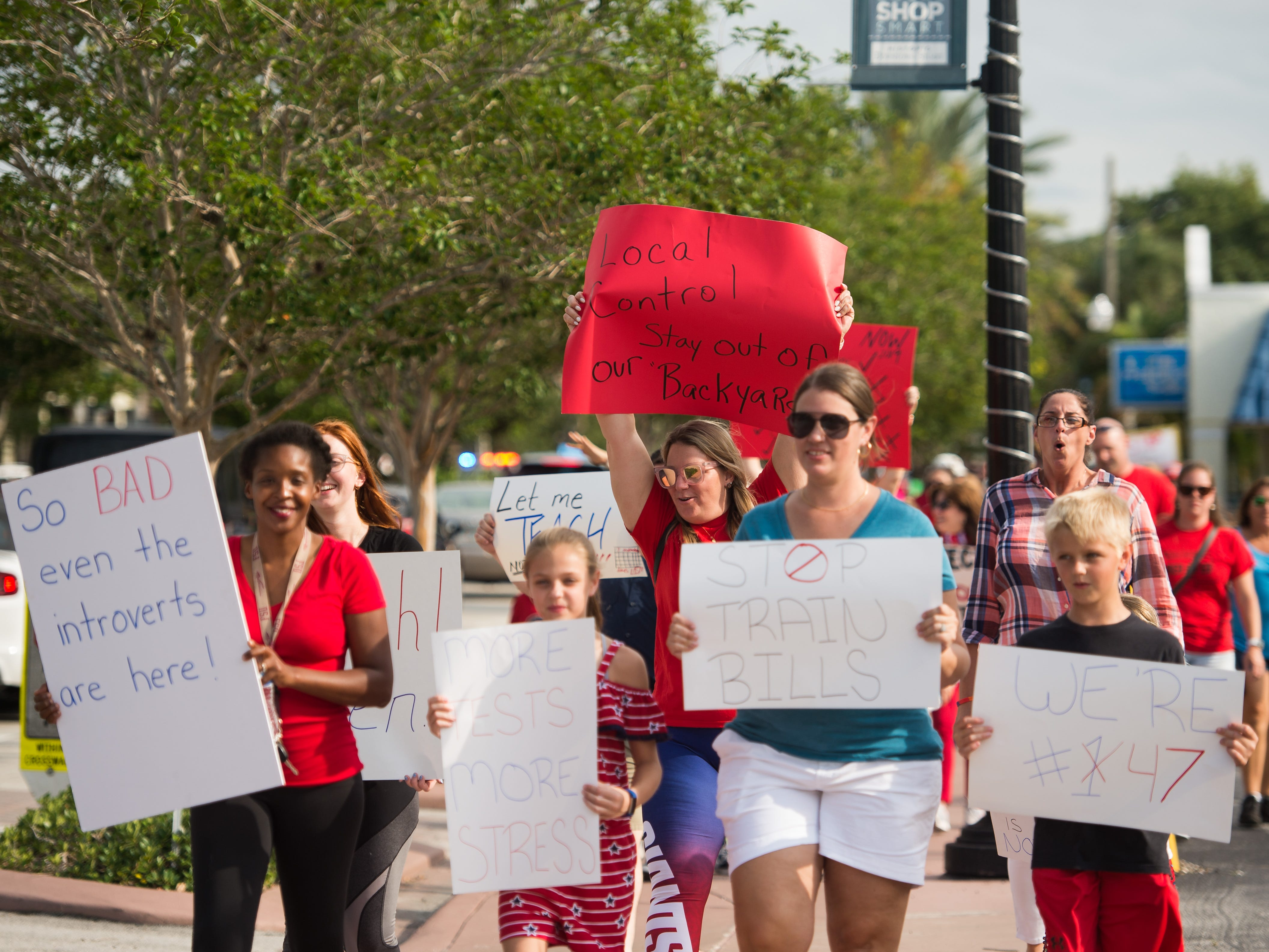 "People march in support of reforms to Florida's public education system Wednesday, May 15, 2019, in Stuart. The event was organized by the Facebook group page ""Reconstruct-ED: A Message to Governor DeSantis,"" which lists over-testing and low teacher pay among their concerns."