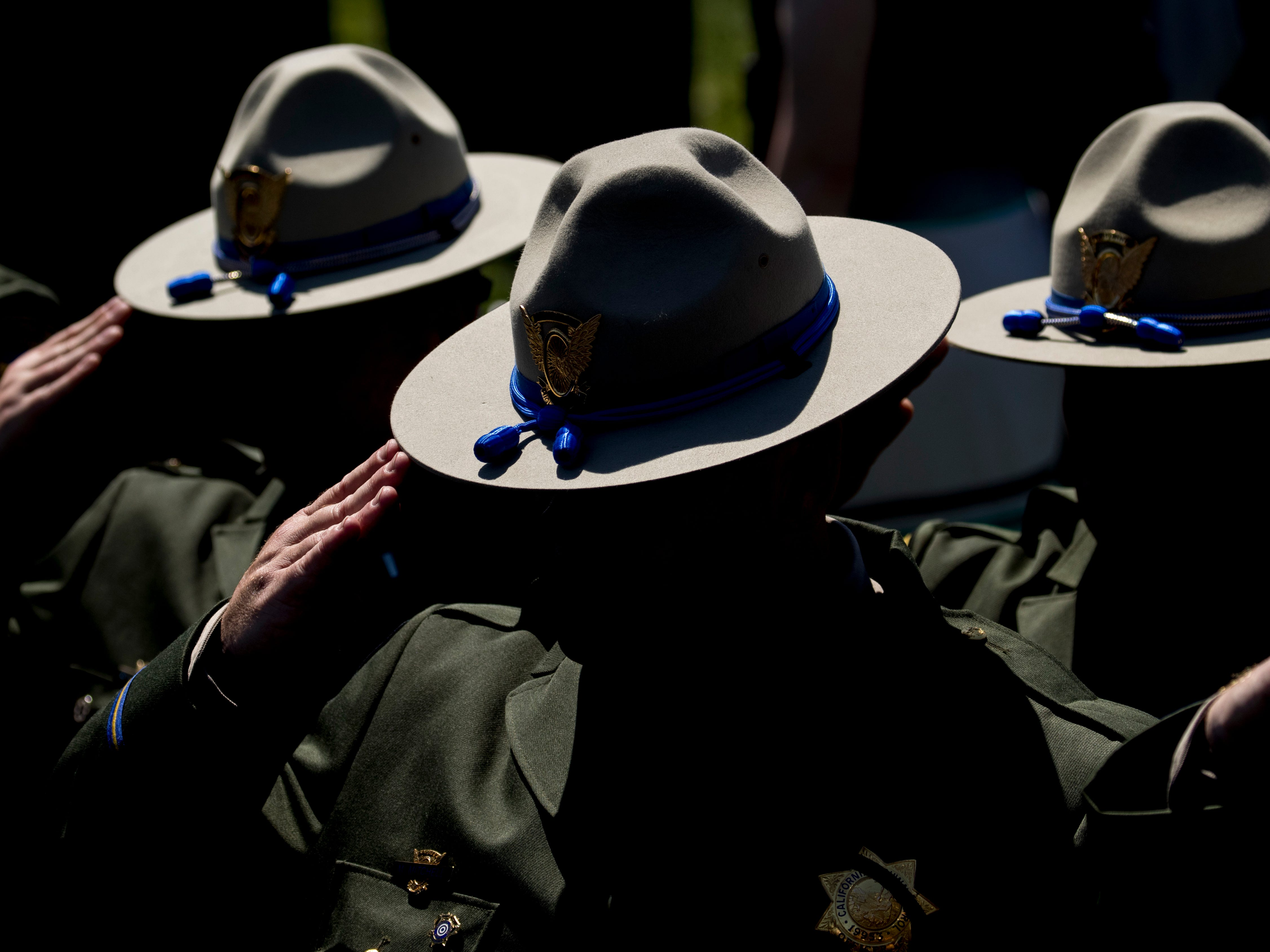 Law enforcement officers stand and salute during the 38th Annual National Peace Officers Memorial Service on the West Lawn of the Capitol Building, Wednesday, May 15, 2019, in Washington.