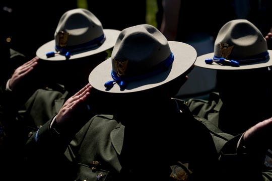 Law enforcement officers stand and salute during the 38th Annual National Peace Officers Memorial Service on the West Lawn of the Capitol Building, May 15, 2019, in Washington.