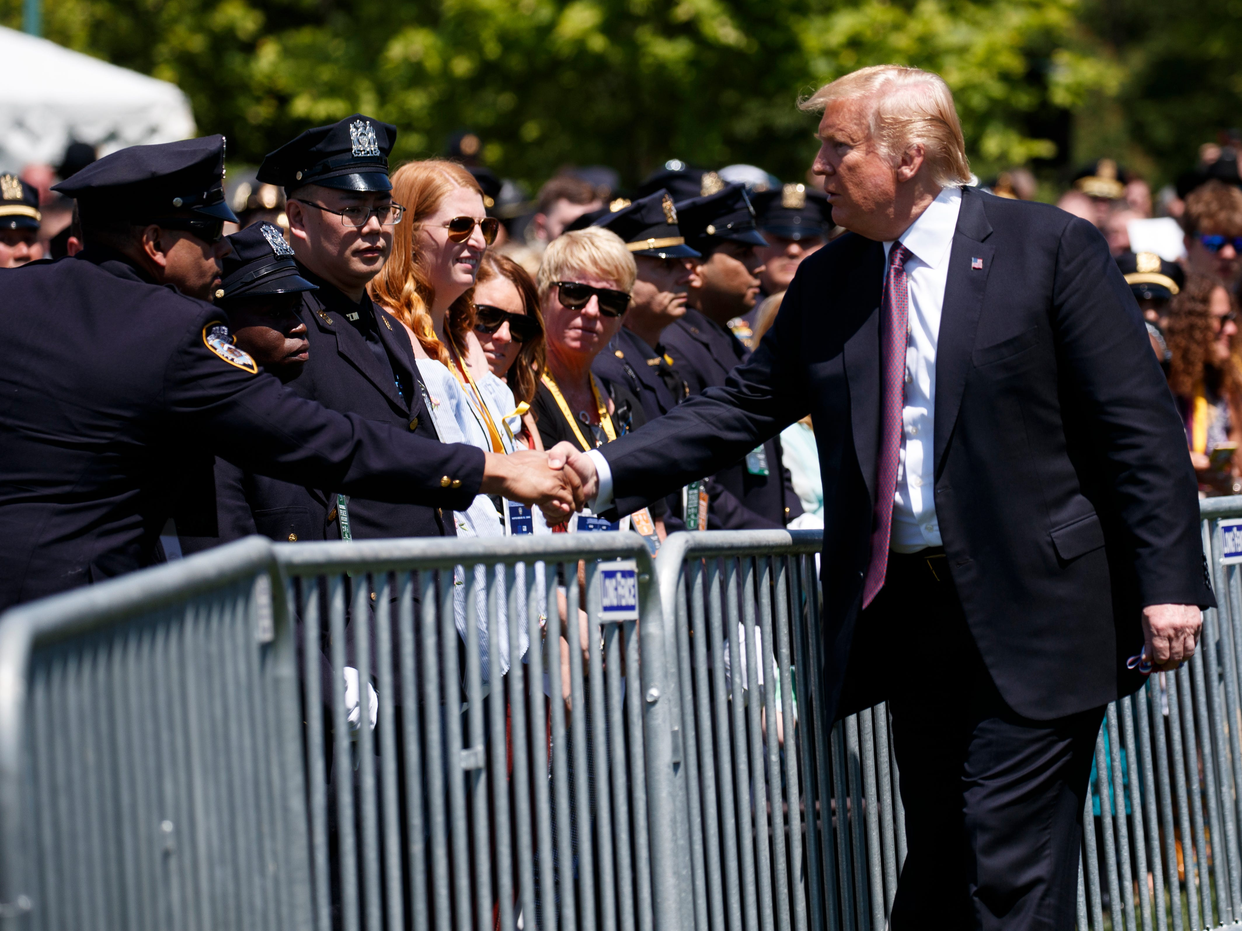 President Donald Trump shakes hands during the 38th Annual National Peace Officers' Memorial Service at the U.S. Capitol, Wednesday, May 15, 2019, in Washington.