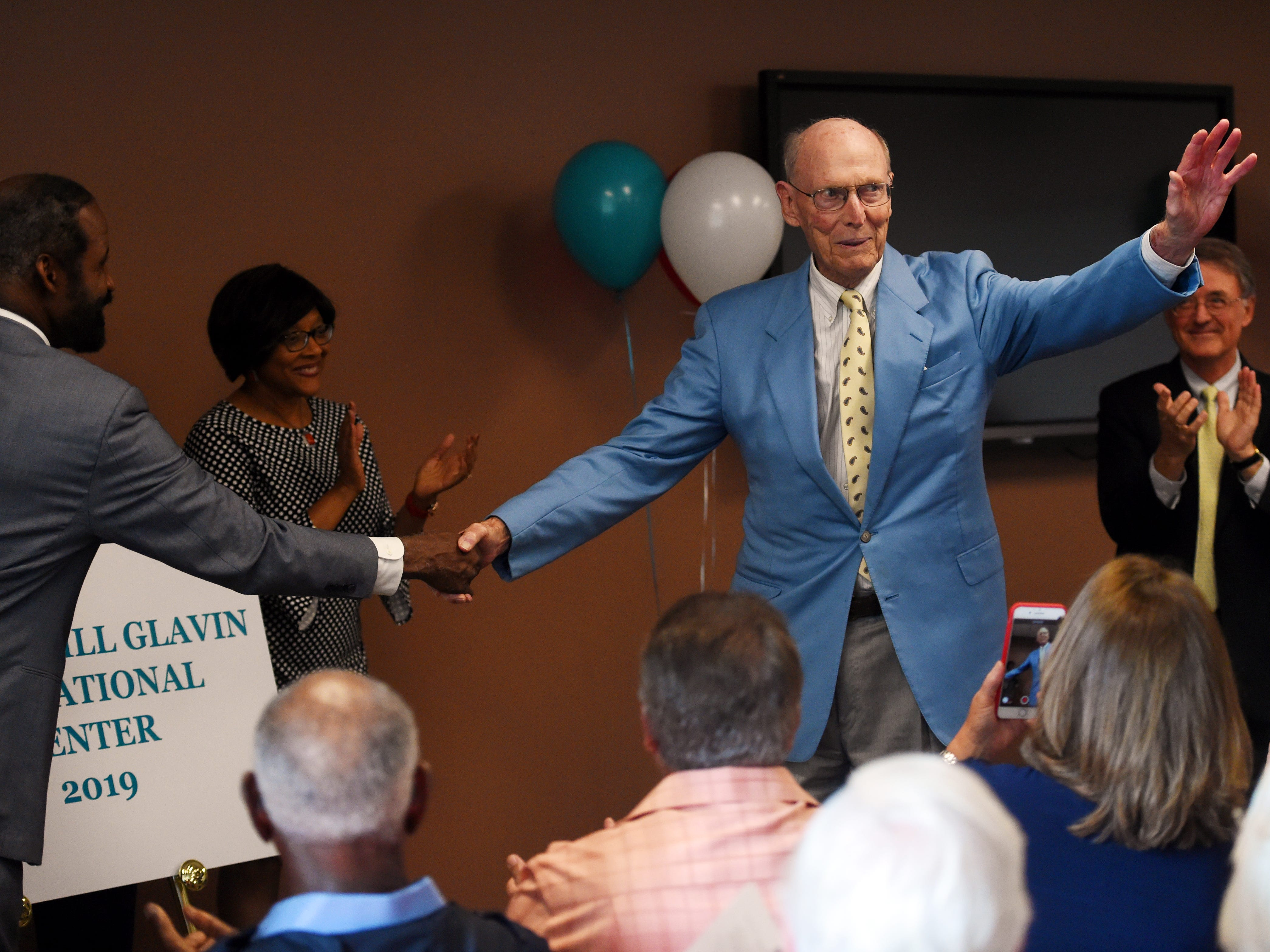 "Bill Glavin waives to the audience after the unveiling of the name of the new building of classrooms at the Gifford Youth Achievement Center on Wednesday, May 15, 2019 during a dedication and ribbon cutting in Gifford. The Cis and Bill Glavin Educational Center is 14,000-square-feet with eight classrooms including a computer lab that will accommodate an additional 140 students. ""I have been involved in over 25 charitable organizations and my wife and I agreed that we have never been a part of an organization as great as this one,"" Glavin said."