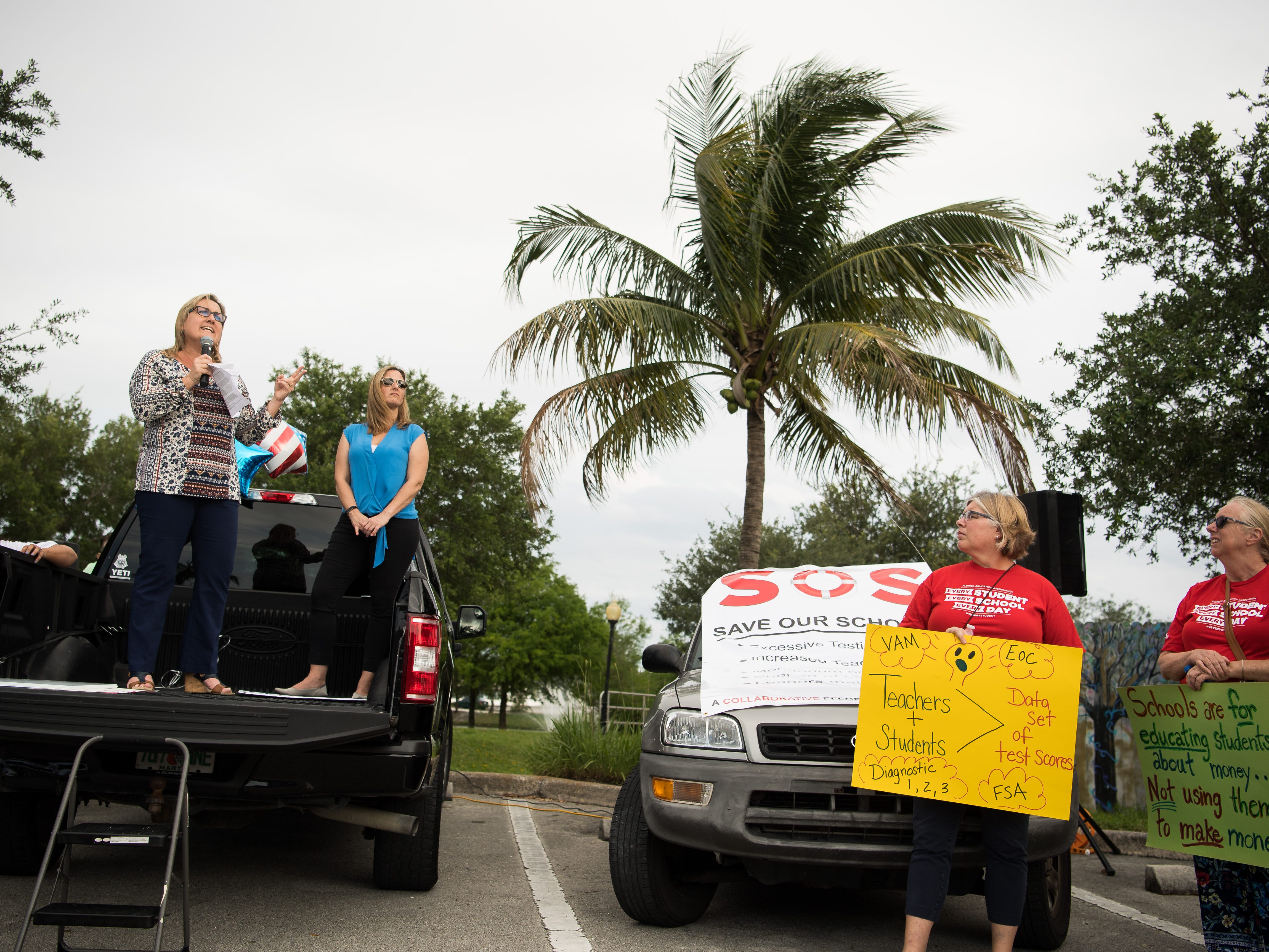 "Stuart resident Tina McSoley (left), a parent and former Martin County School Board member who founded Reconstruct-ED of Stuart, speaks to a crowd of hundreds gathered to march in support of reforms to Florida's public education system Wednesday, May 15, 2019, in Stuart. ""This is the beginning of an eight-month program to educate Florida on education,"" she said. ""There's a lot of work to be done statewide, and I believe most of our issues come from mandates from Tallahassee,"" she added, ""and until we get Tallahassee's attention, our hands are tied locally."" The event was promoted on the Facebook group page ""Reconstruct-ED: A Message to Governor DeSantis,"" which lists over-testing and low teacher pay among its concerns."