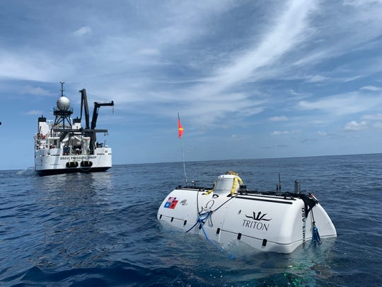 DSV (Deep Submergence Vehicle) Limiting Factor (in foreground), designed and built by Triton Submarines of Sebastian, prepares to dive to the deepest spot in any of the world's oceans - the Mariana Trench near Guam during the last week of April 2019.