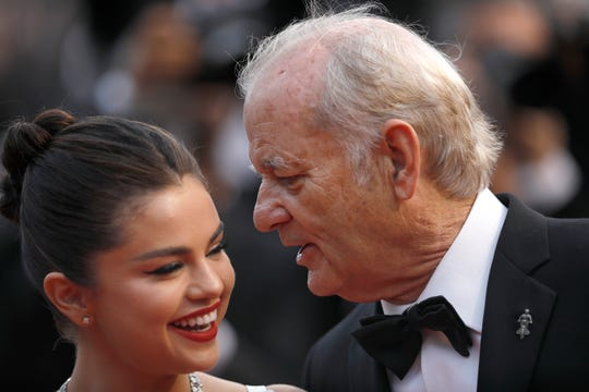 Actors Selena Gomez, left, and Bill Murray pose for photographers upon arrival at the opening ceremony and the premiere of the film 'The Dead Don't Die' at the 72nd international film festival, Cannes, southern France, Tuesday, May 14, 2019.