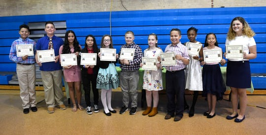 """Twelve students across the Vineland Public School District were selected to receive a Giraffe Hero Award during a special ceremony at the school district's administrative offices on Wednesday, May 15, 2019. Left to right, Angel Rivera, Nicholas Guaciaro, Kimberly Gonzalez, Paola Gutierrez, Danica Newcomb, Zachary Zavis, Riley Rizzo, Julian Barrera, Oluwatomisin """"Michelle"""" Akinyoade, Marely Garcia Flores and Sofia Amato. Jiya Patel not present at the ceremony due to Barse School class trip."""