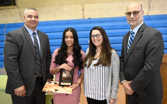 Wallace Middle School student Kimberly Gonzalez was presented with a Giraffe Hero Award during a special ceremony on Wednesday, May 15, 2019.