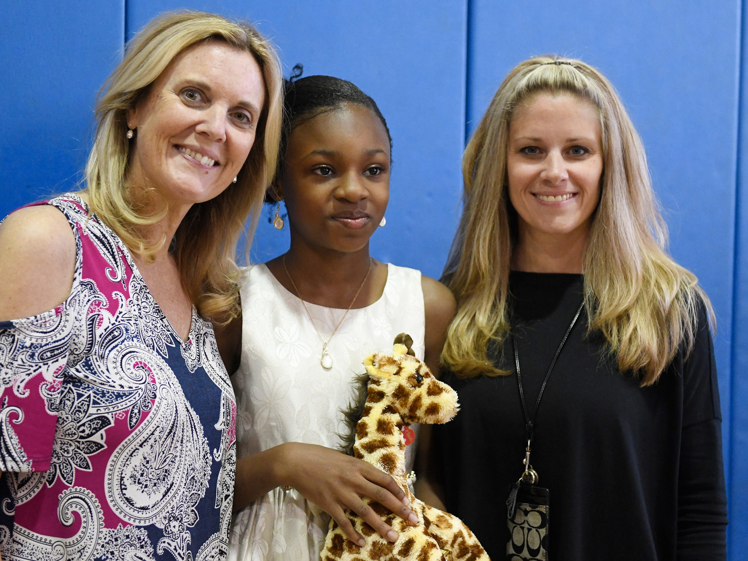 """Sabater Elementary School student Oluwatomisin """"Michelle"""" Akinyoade was presented with a Giraffe Hero Award during a special ceremony on Wednesday, May 15, 2019."""