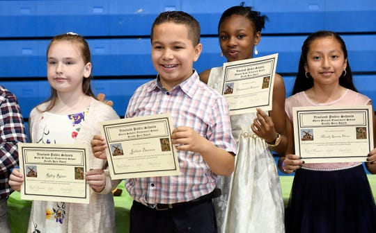 """From left to right, Riley Rizzo, Julian Barrera, Oluwatomisin """"Michelle"""" Akinyoade and Marely Garcia Flores were each presented with a Giraffe Hero Award during a special ceremony on Wednesday, May 15, 2019."""