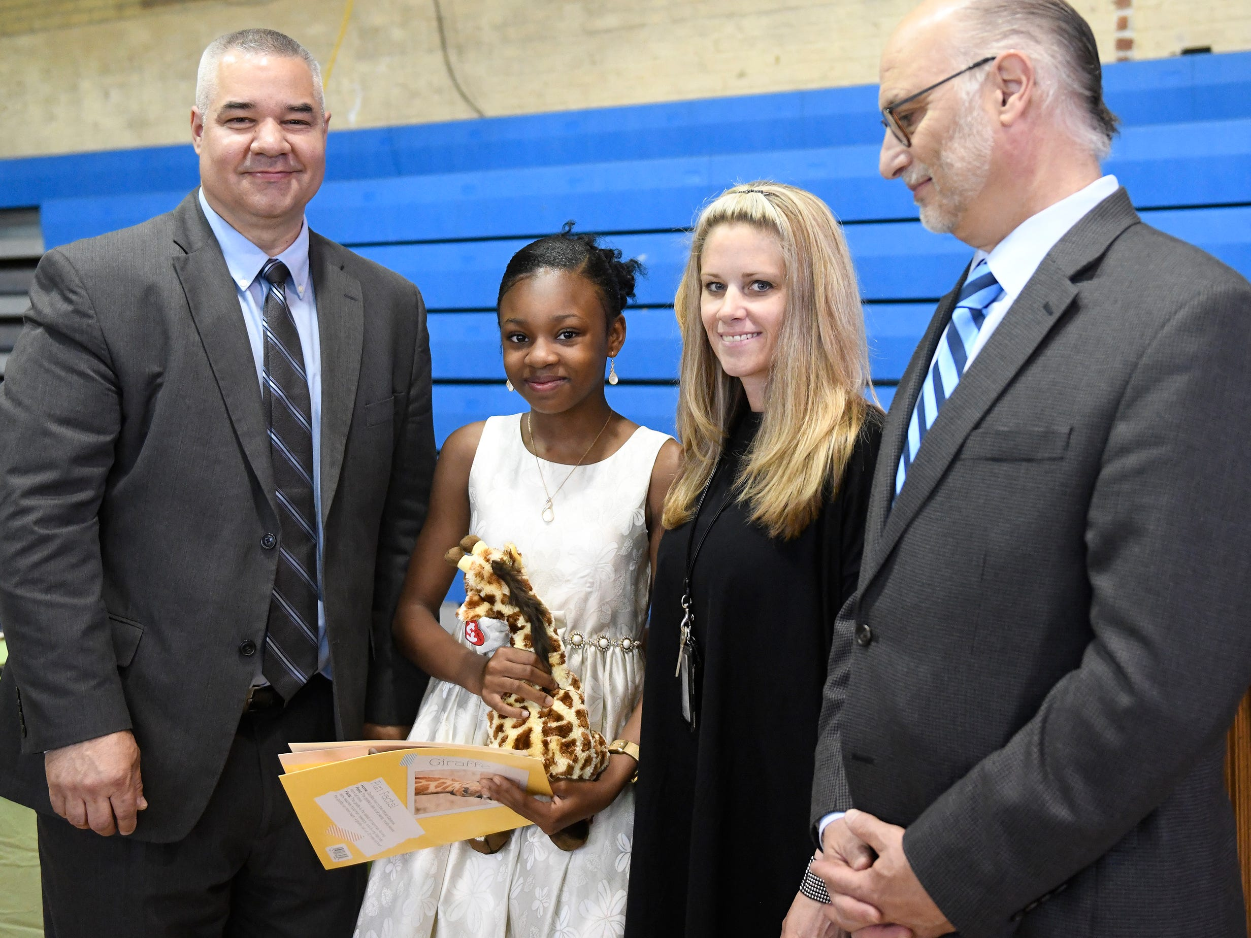 """Rossi Elementary School student Oluwatomisin """"Michelle"""" Akinyoade was presented with a Giraffe Hero Award during a special ceremony on Wednesday, May 15, 2019."""