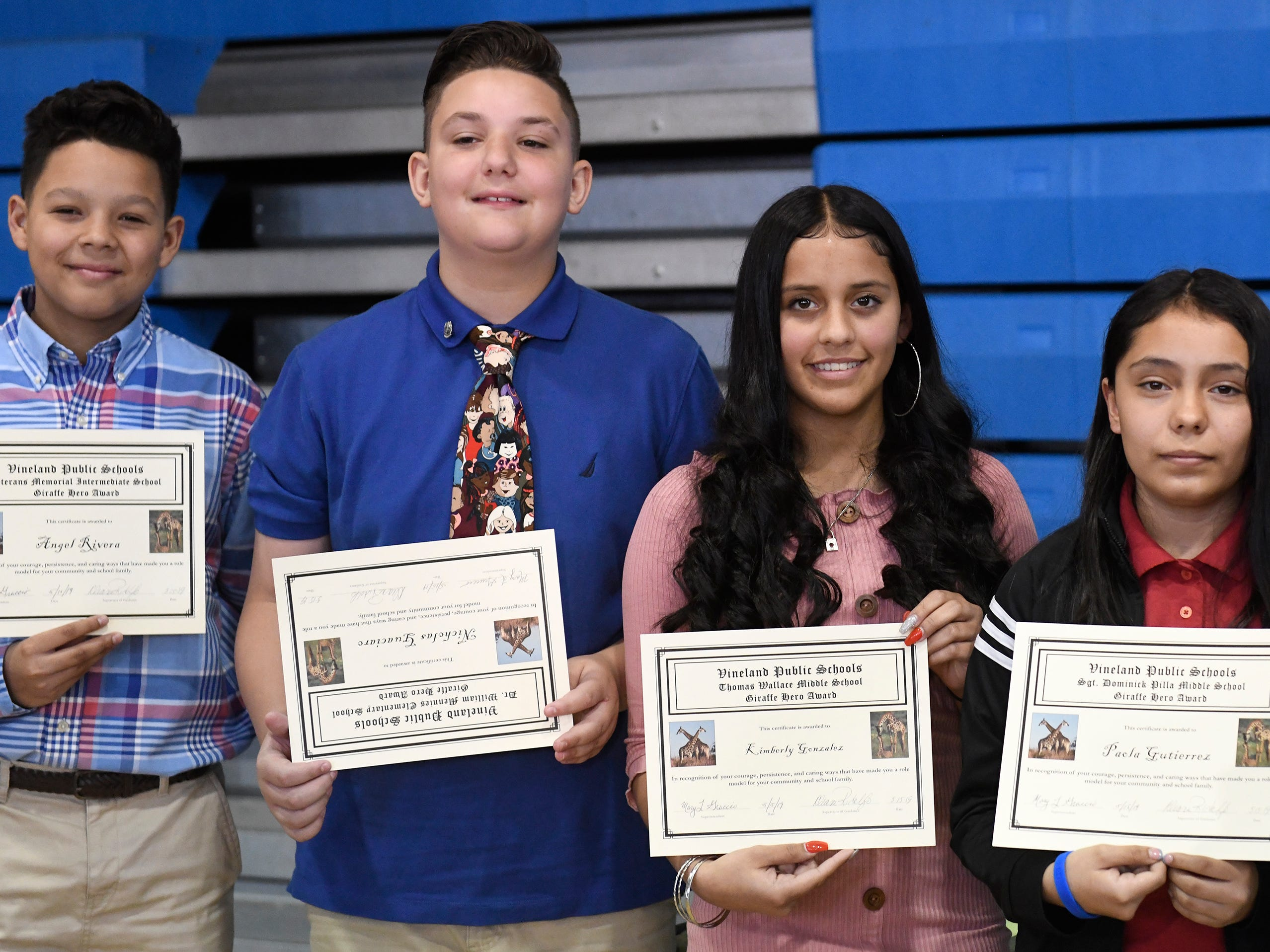 From left to right, Angel Rivera, Nicholas Guaciaro, Kimberly Gonzalez, Paola Gutierrez and Danica Newcomb were each presented with a Giraffe Hero Award during a special ceremony on Wednesday, May 15, 2019.
