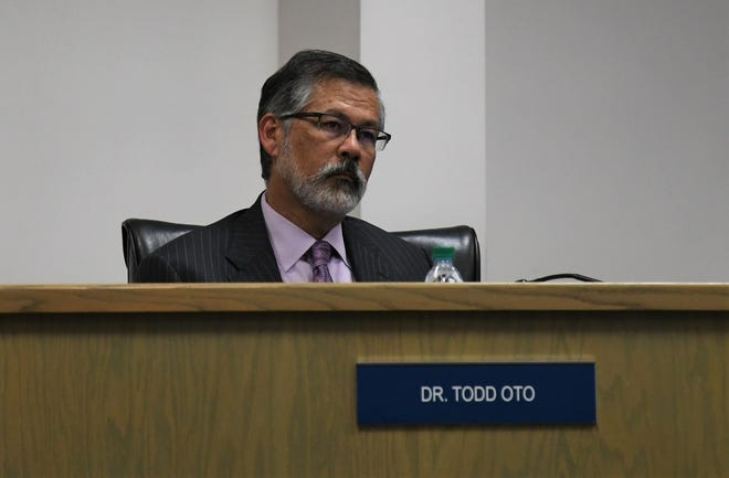 Todd Oto sits in an unfamiliar seat at his first Visalia Unified School District meeting since being forced to resign. He will remain on as an adviser until June 11.