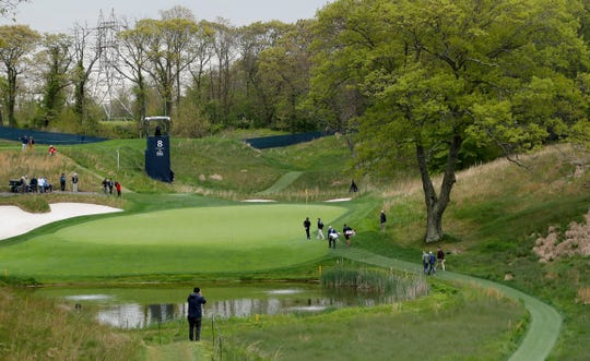 Rory McIlroy, center left, and Russell Knox walk onto the eighth green during a practice round for the PGA Championship golf tournament, Tuesday, May 14, 2019, in Farmingdale, N.Y. As part of the tournament at the public course, Gov. Andrew Cuomo announced kids can play free at state-owned courses on July 20.