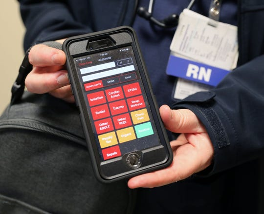 Glenn Albin, R.N. and a paramedic with the South Orangetown ambulance corps, shows the home screen for a phone medical app called Twiage, at Montefiore Nyack Hospital, May 15, 2019.