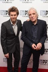 Actor Willem Dafoe (L) and director Abel Ferrara attend the 'Pasolini' premiere,