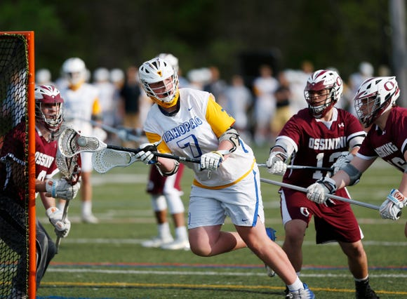 Mahopac's Ryan Maloney passes the ball away from the goal as Ossining's, from left, TJ Komosa, Joe Fragale and Joe Nolan deny his shot during Wednesdays' game at Mahopac High School on May 15, 2018.
