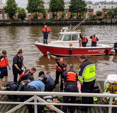 Firefighters team up with rowers to save woman from Christina River
