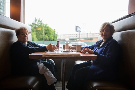 Politically split friends Elaine Reginelli, left, would support Joe Biden in a presidential election and Lorraine McNelis supports President Donald Trump.