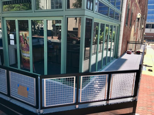 A new dog-friendly open-air corner bar is being built at The Queen in Wilmington with accordion-style folding windows. It could open as early as mid-June.