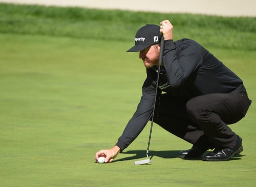 Practice round: Jimmy Walker walks lines up his putt on the 16th green.