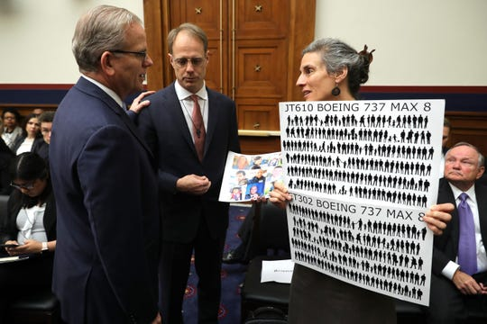 Federal Aviation Administration acting Administrator Daniel Elwell, left, talks with Michael Stumo and Nadia Milleron, the parents of Ethiopian Air crash victim Samya Stumo, before a hearing of the House Aviation Subcommittee