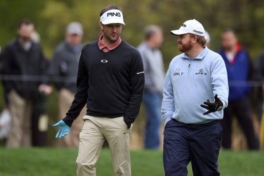 Practice round: Bubba Watson and J.B. Holmes talk on the third green.