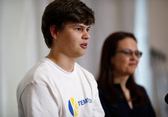Joshua Jones speaks during a news conference as his mother, Lorie, looks on.