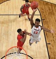 Virginia Cavaliers guard De'Andre Hunter (12) shoots against the Texas Tech Red Raiders in the championship game of the 2019 men's Final Four at US Bank Stadium.