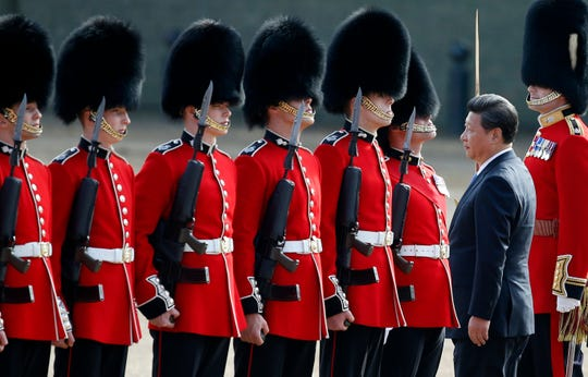 Chinese President Xi Jinping inspects a guard of honor during the official welcome ceremony at Horse Guards Parade in London, Oct. 20, 2015.