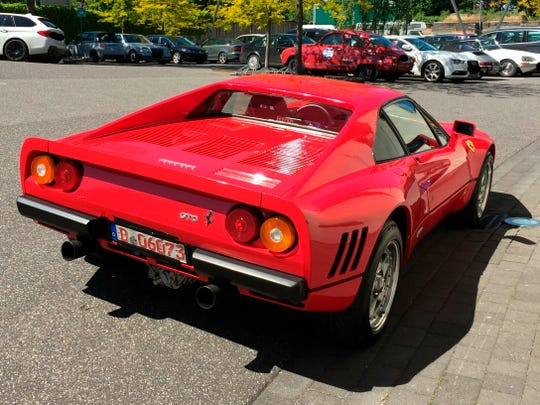 The Monday, May 13, 2019 photo provided by the police in Duesseldorf shows the Ferrari 288 GTO. German police have recovered a valuable 1980s Ferrari stolen during a test drive and are now searching for the man who is believed to have sped off with the car while posing as a would-be buyer. The red Ferrari 288 GTO, first registered in 1985, is believed to be worth more than 2 million euros ($2.2 million).