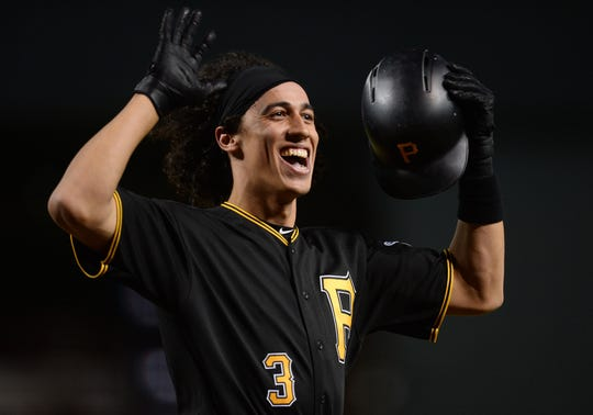 Pirates shortstop Cole Tucker reacts after hitting a home run against the Diamondbacks.