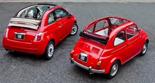 A modern Fiat 500 convertible and one of the original models.