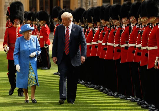 Queen Elizabeth II and President Donald Trump inspect the guard of honor formed of the Coldstream Guards at Windsor Castle in July 2018.