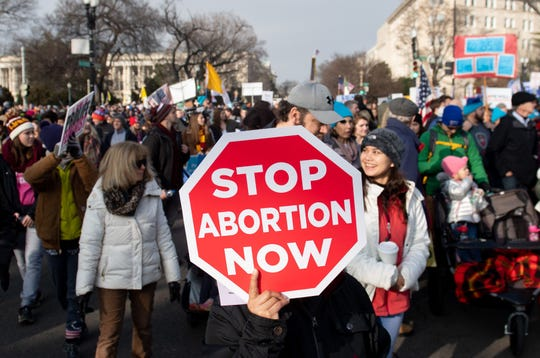 "In this file photo taken on Jan. 18, 2019, anti-abortion activists participate in the ""March for Life,"" an annual event to mark the anniversary of the 1973 Supreme Court case Roe v. Wade, which legalized abortion in the US, outside the US Supreme Court in Washington, DC."