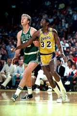 Larry Bird, left, and Magic Johnson created a drama that endures to this day, even if the style of play doesn't hold up.
