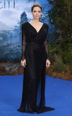 """LONDON, ENGLAND MAY 08: Angelina Jolie attends a private reception as costumes and props from Disney's """"Maleficent"""" are exhibited in support of Great Ormond Street Hospital at Kensington Palace on May 8, 2014 in London, England.  (Photo by Mike Marsland/WireImage) ORG XMIT: 488492667 ORIG FILE ID: 488777765"""