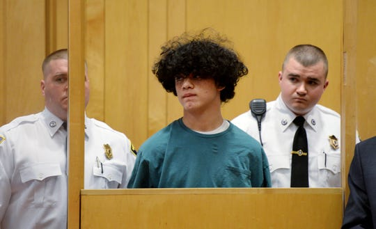 Mathew Borges, 15, center, attends his arraignment in Lawrence District Court in Lawrence, Mass, Monday, Dec. 5, 2016. Borges was held without bail after pleading not guilty at the brief arraignment Monday on a first-degree murder charge. (Paul Bilodeau/The Eagle-Tribune via AP, Pool) ORG XMIT: MANOA904 [Via MerlinFTP Drop]