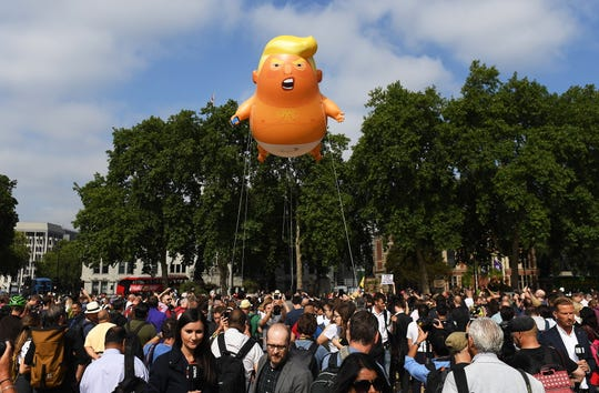 "The ""Donald Trump Baby Blimp"" balloon floats over Parliament Square during a protest in London, in July 2018."