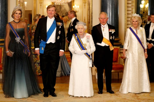 (L-R) Queen Maxima of The Netherlands, King Willem-Alexander of The Netherlands, Queen Elizabeth II, Prince Charles, Prince of Wales and his wife, Camilla, Duchess of Cornwall, pose during a state banquet at Buckingham Palace on Oct. 23, 2018 in London.