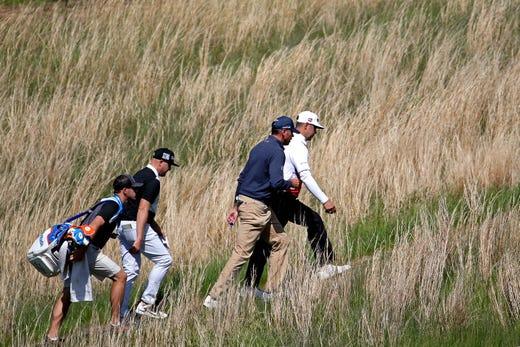 Practice round: Gary Woodland and Matt Kuchar walk toward the sixth hole.