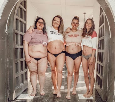 Four moms who had never met before got together to pose for a photo showing their postpartum bodies.