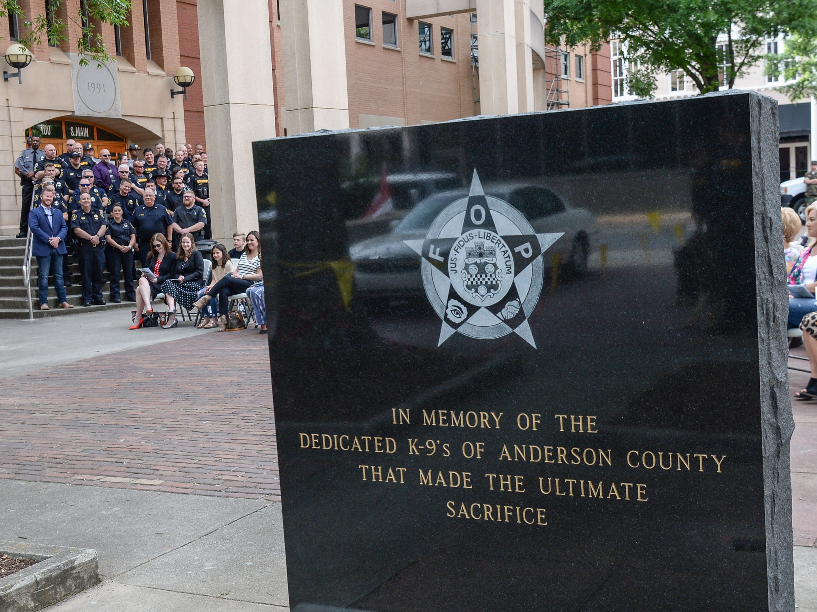 The new Fraternal Order of Police monument for fallen K-9 Duchess and Hyco, unveiled during the 2019 Peace Officer Memorial Service Wednesday May 15, 2019. People attended to help honor the lives of officers lost in the line of duty.
